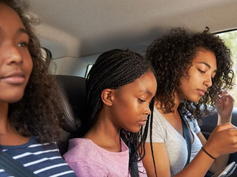 Teen Girls on Road Trip; Courtesy of Monkey Business Images/Shutterstock.com