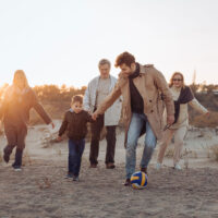 Multigenerational Family on the Beach; Courtesy of LightField Studio/Shutterstock.com