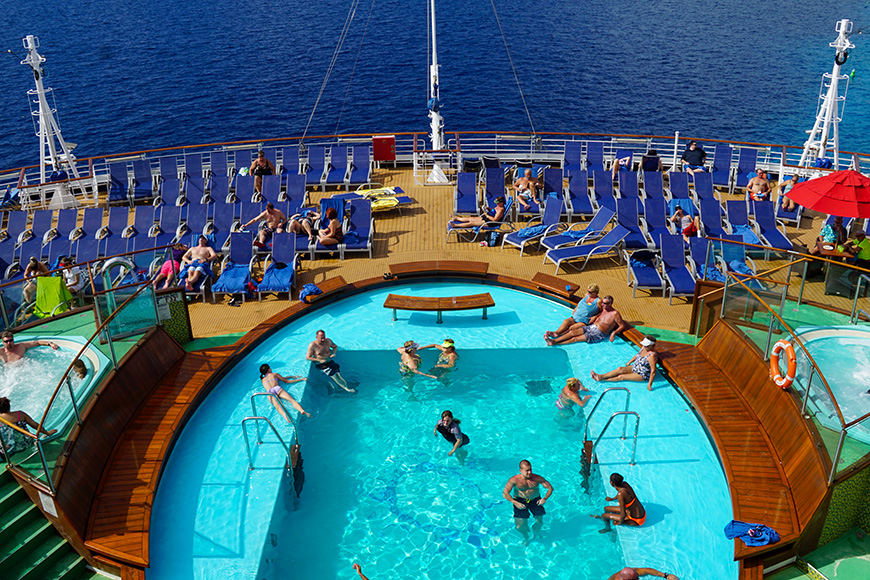 Poolside on the Carnival Breeze docked in Miami, Florida,; Courtesy of Ritu Manoj Jethani/Shutterstock