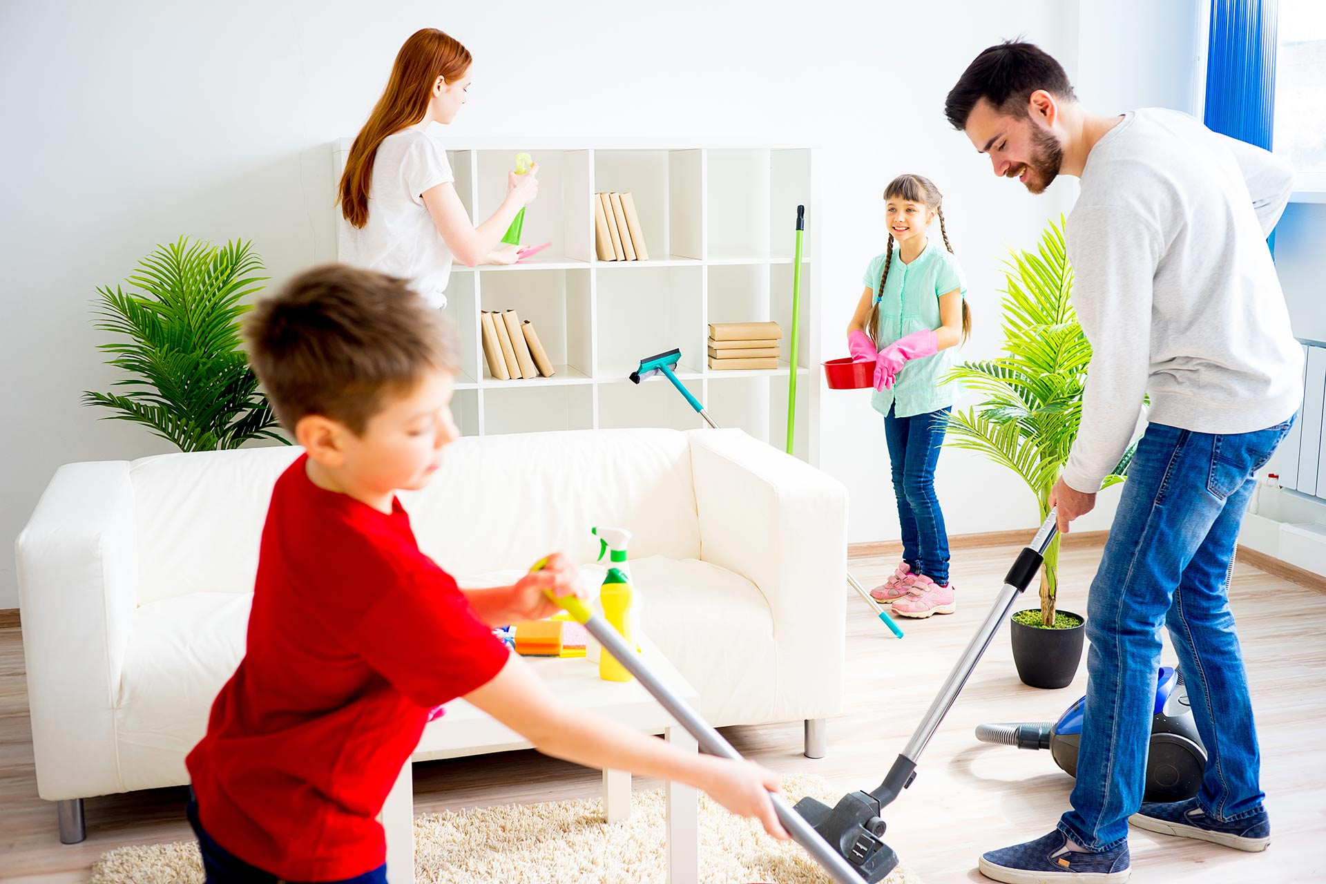 A family cleaning the house before going away on vacation.