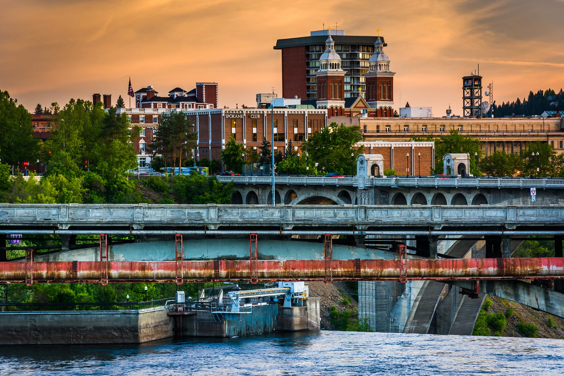Bridges over the Spokane River and buildings at sunset in Washington