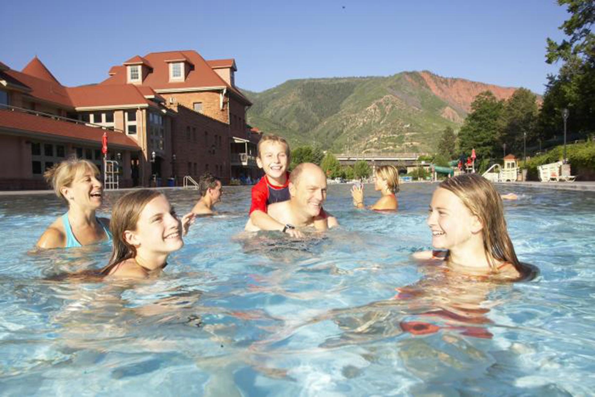 A family enjoying themselves at Glenwood Hot Springs in Glenwood Springs, Colorado.