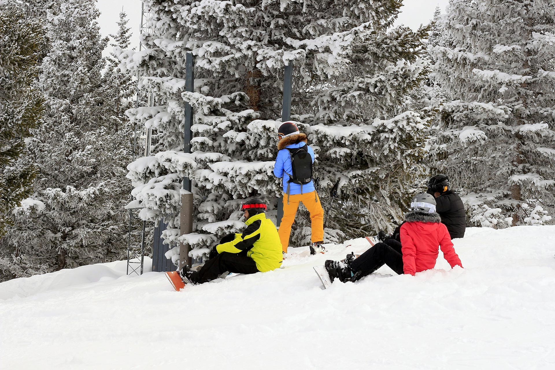 A group of teens taking a break on the mountain at Snowmass in Colorado.