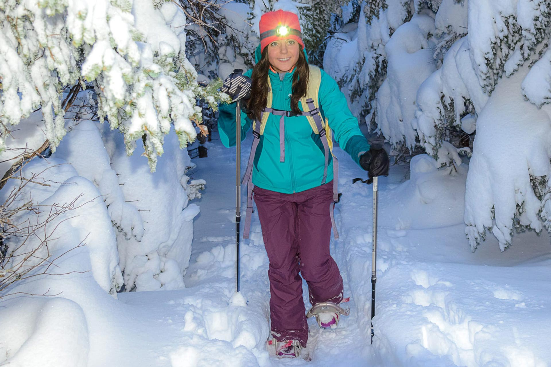 A young woman on a snowshoeing hike at Stratton in Vermont.