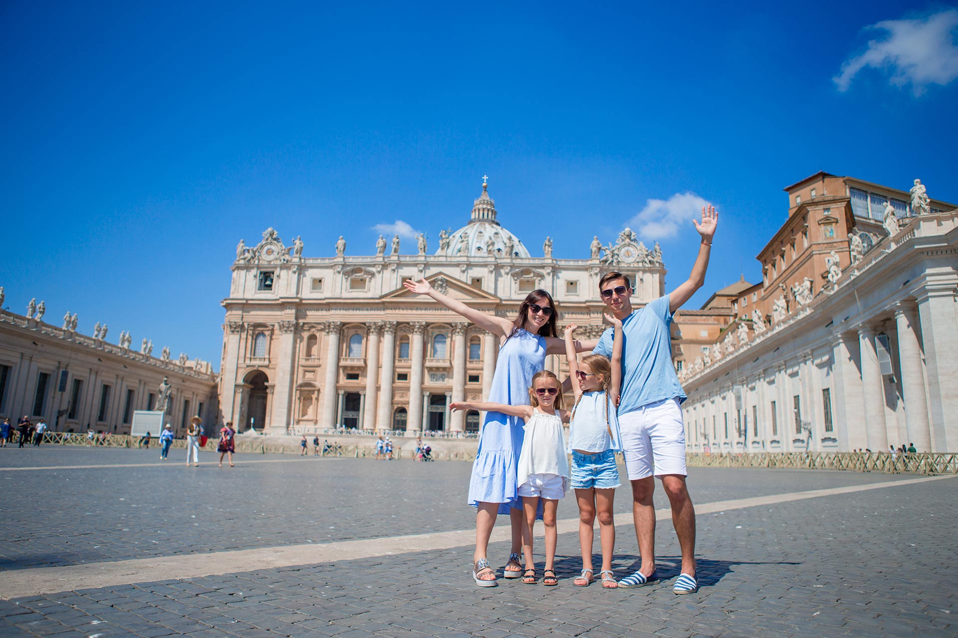 A family visiting Vatican City in Italy.