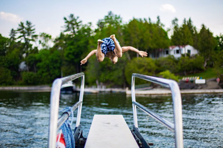 Boy Jumping in Lake at Basin Harbor Resort in Vergennes, Vermont