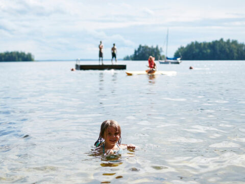 Little Girl Swimming at Migis Lodge in South Casco, ME; Courtesy of Migis Lodge