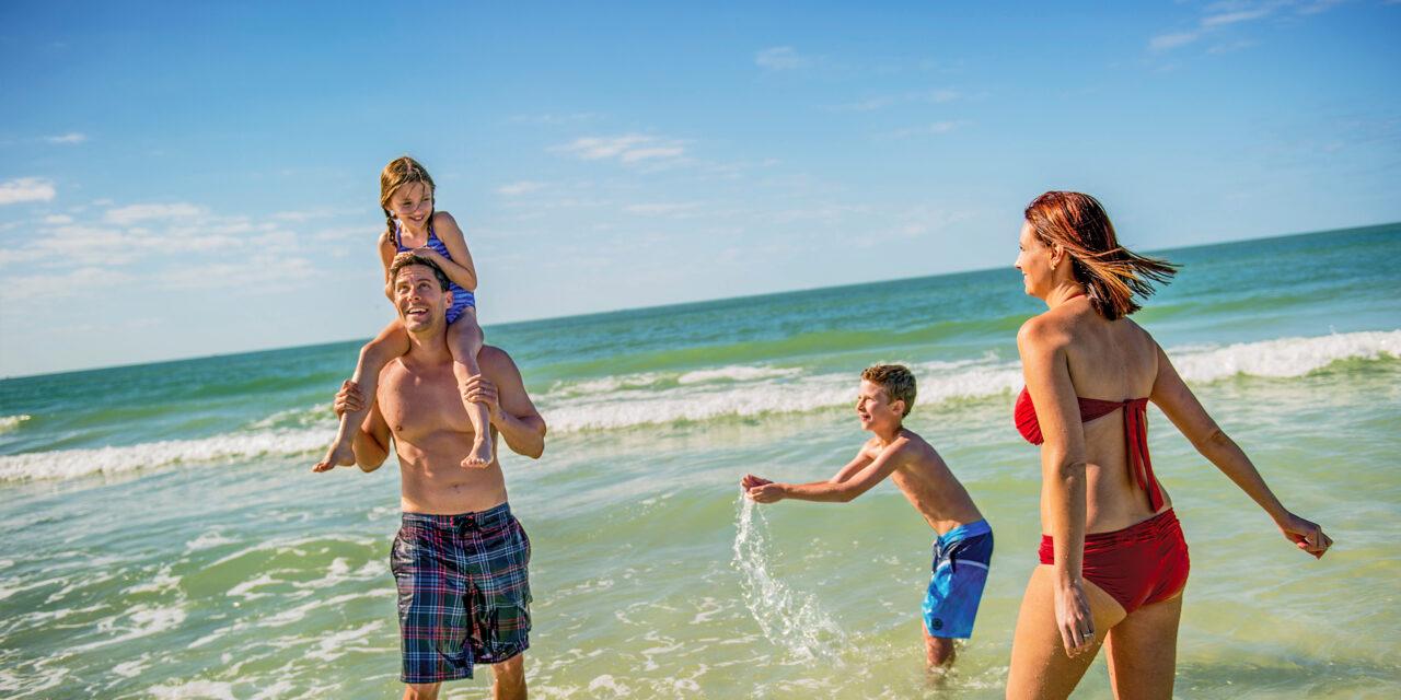 family playing in ocean in siesta beach florida; Courtesy Visit Sarasota