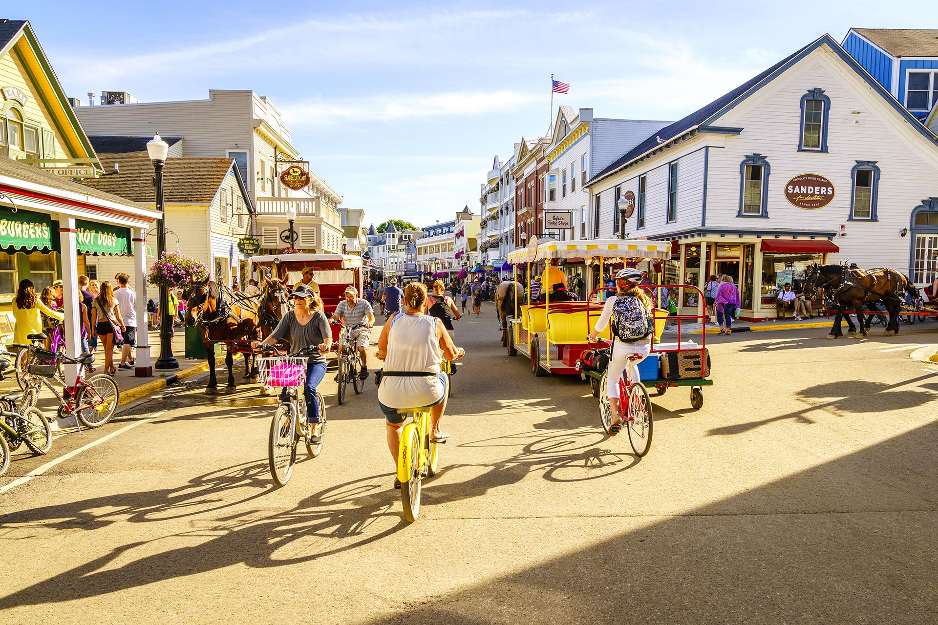 Families biking around Mackinac Island in Michigan.