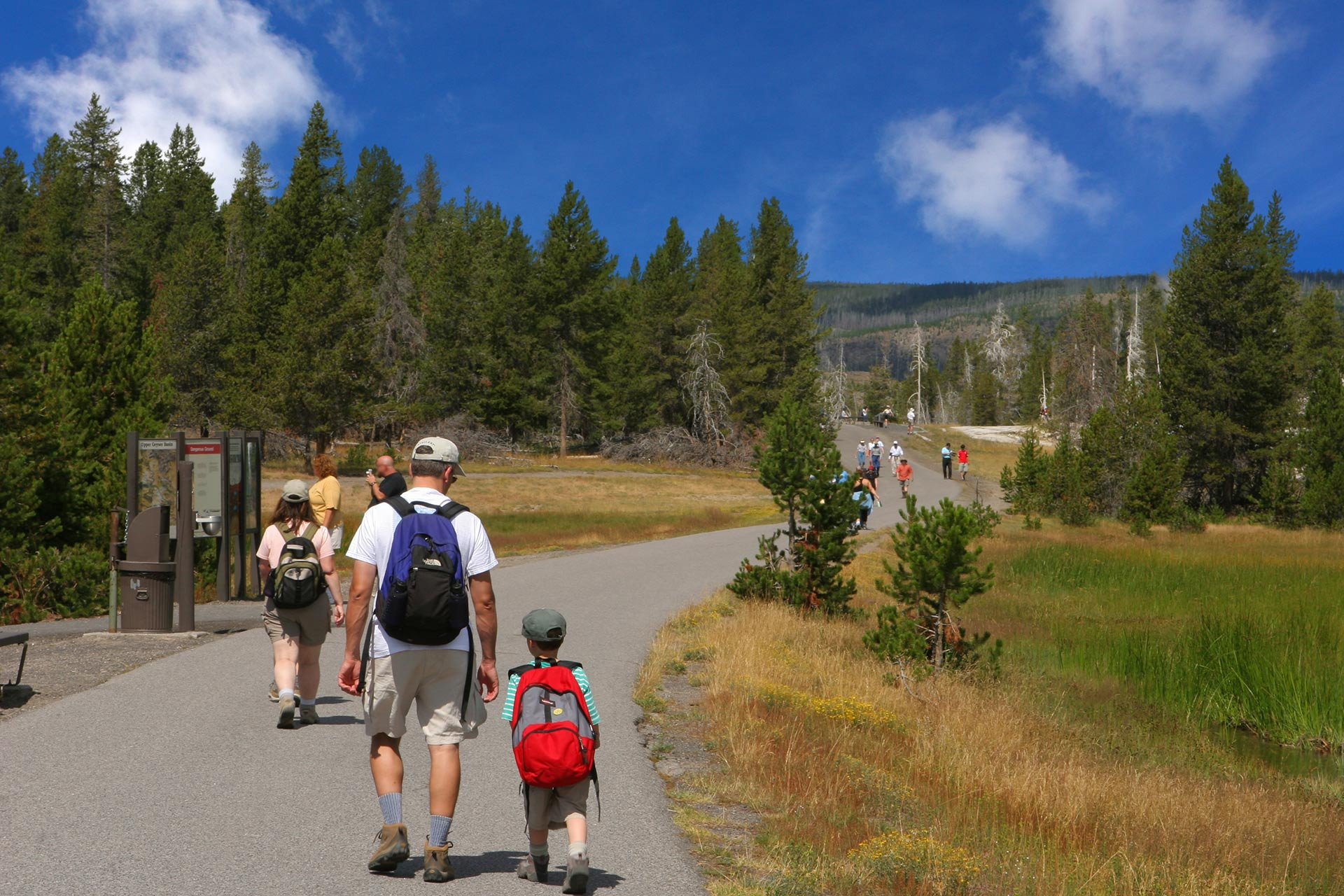 A family hiking at Yellowstone National Park.