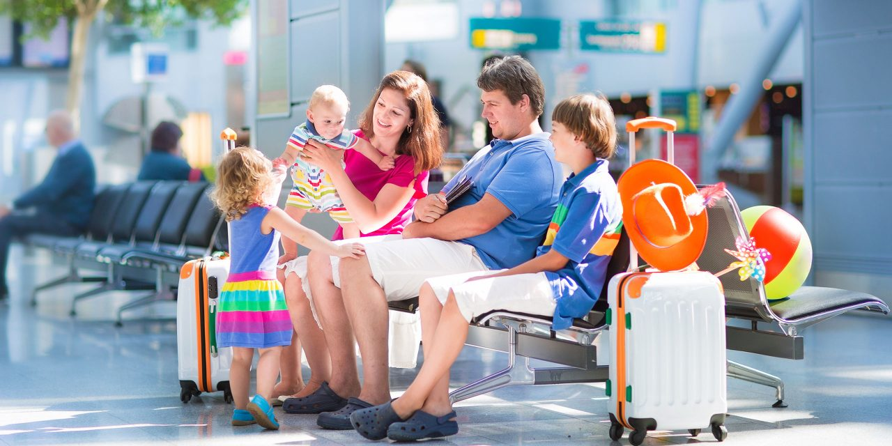 Family at Airport; Courtesy of FamVeld/Shutterstock.com