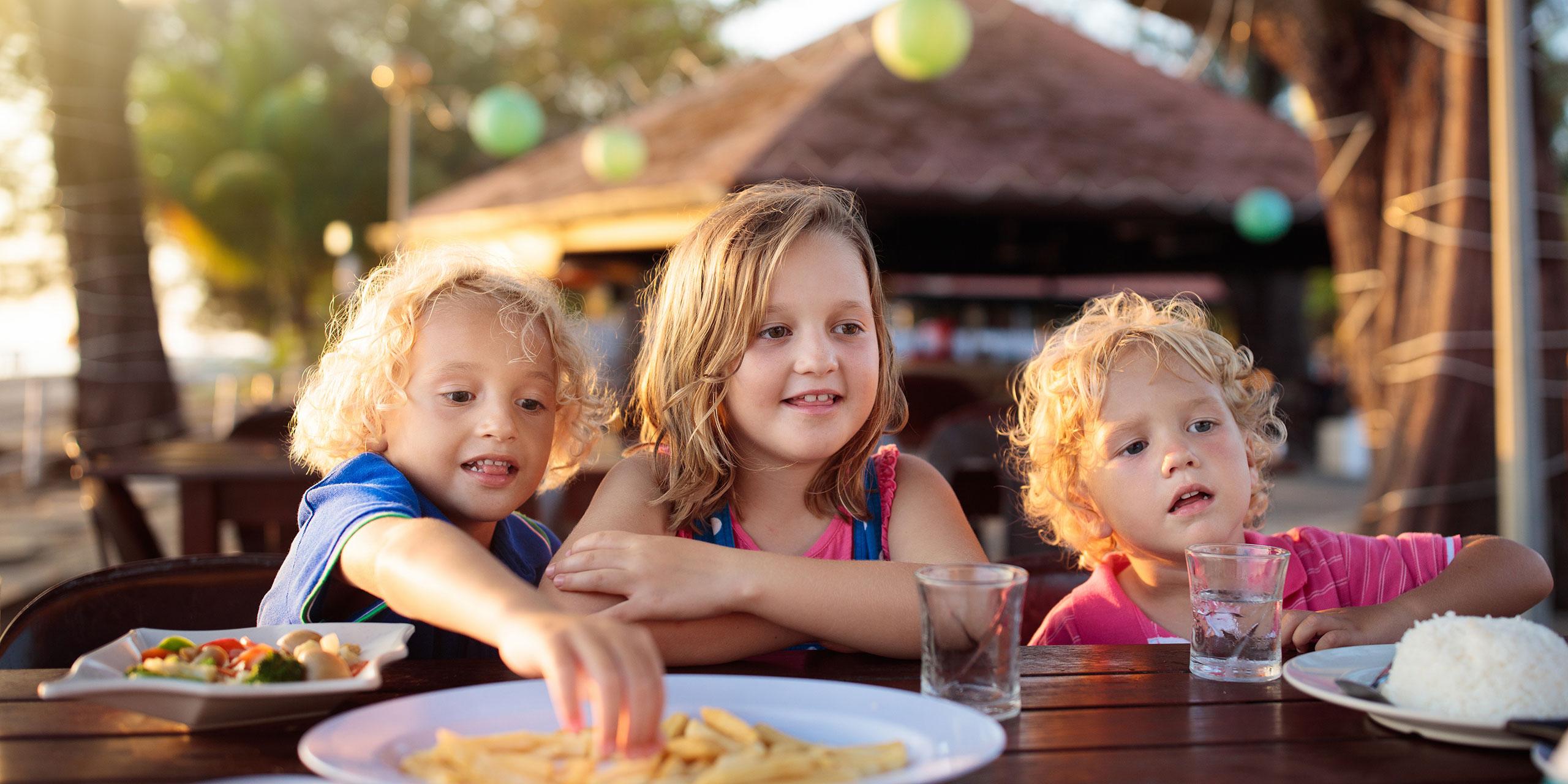 Kids Eating at Resort; Courtesy of FamVeld/Shutterstock.com