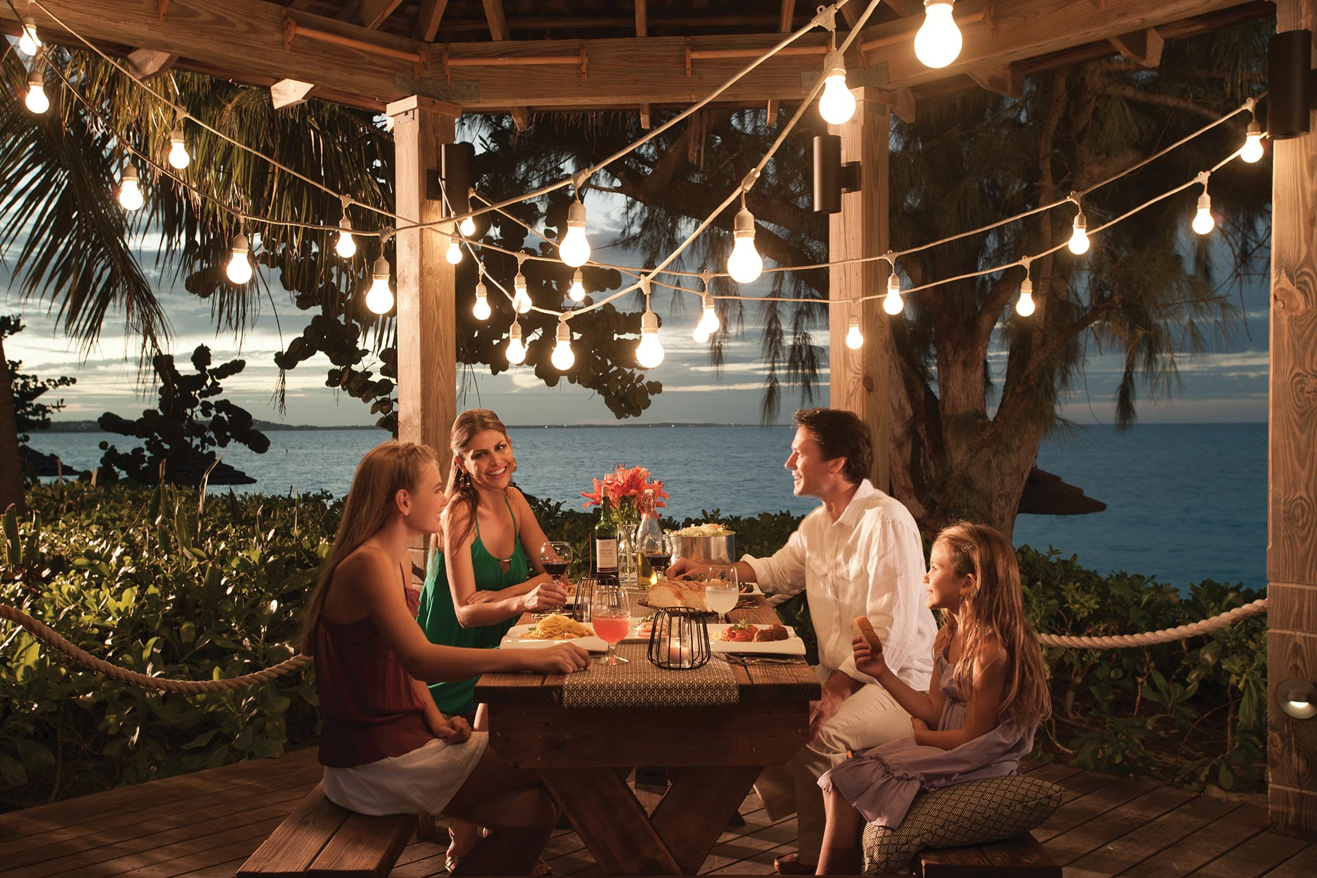 A family enjoying a meal at Beaches Turks & Caicos.