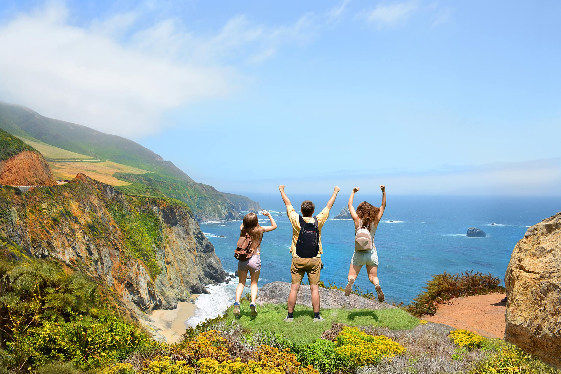 A group of kids enjoying the beautiful views of Big Sur, California