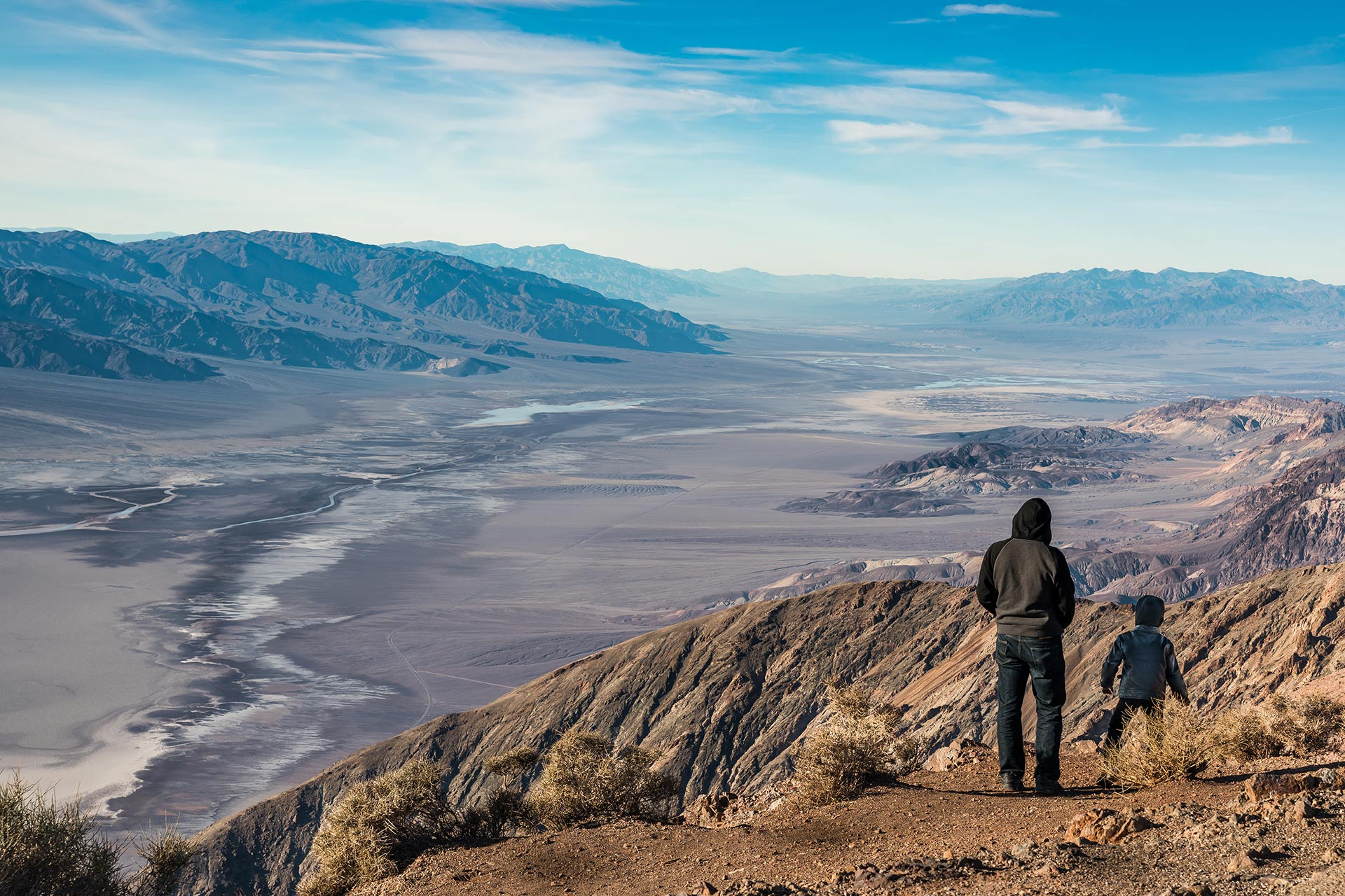 A father and son admiring views of Death Valley National Park from Dante's View in California