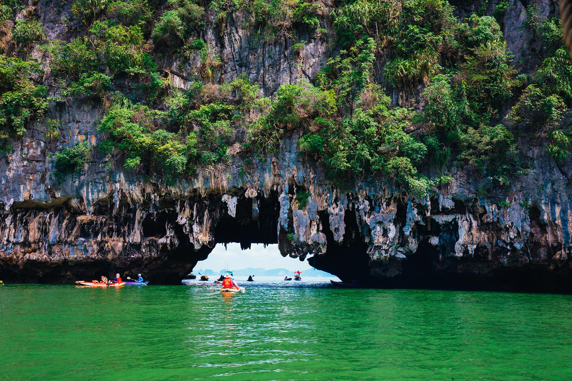 Kayaking through limestone cliffs in Phang-nga Bay in Thailand