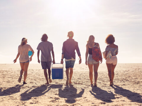 Teens With Beach Cooler; Courtesy of Jacob Lund/Shutterstock.com