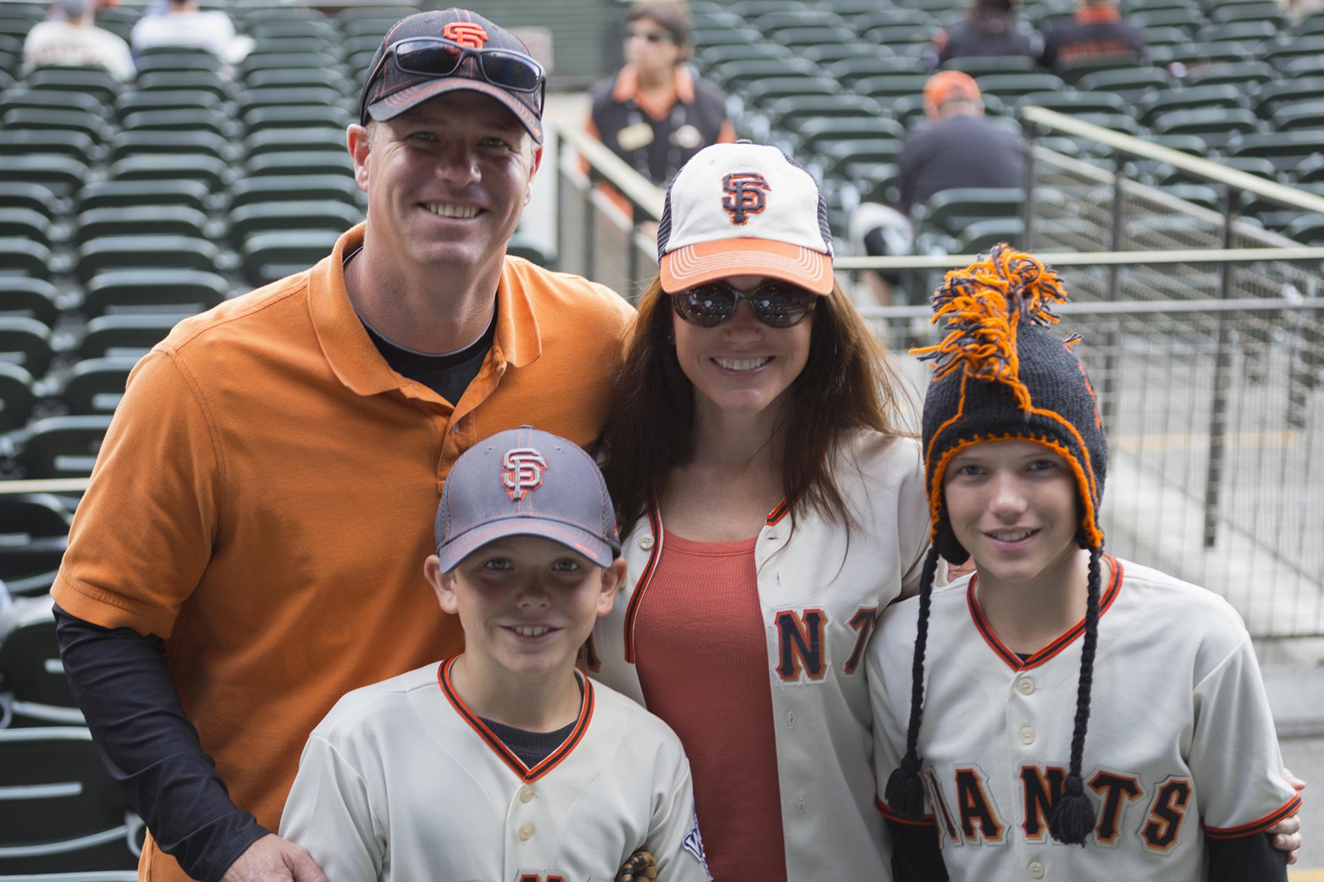 A family at a baseball game in San Francisco, California.
