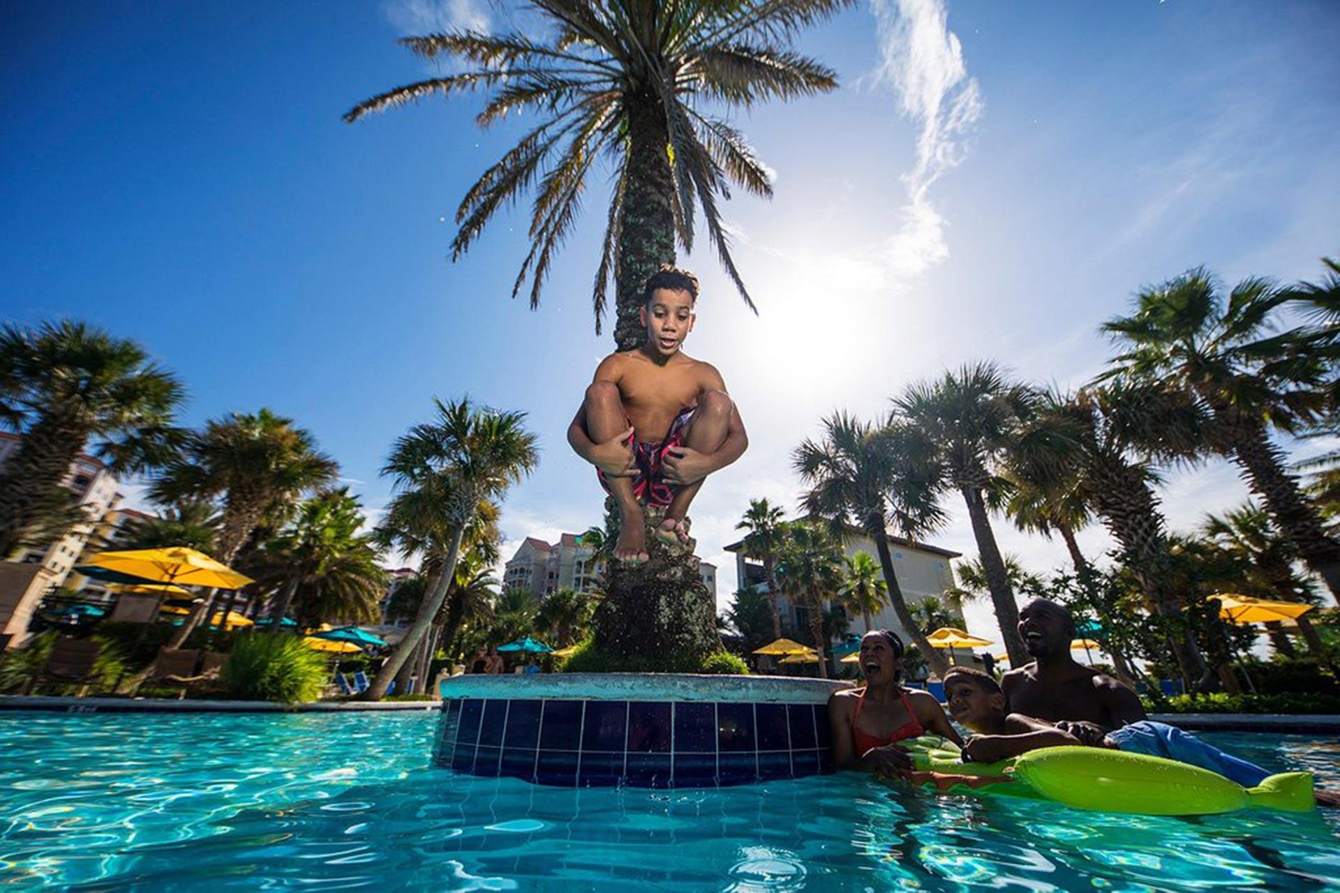Boy Jumping in Pool at Hammock Beach Resort; Courtesy of Hammock Beach Resort