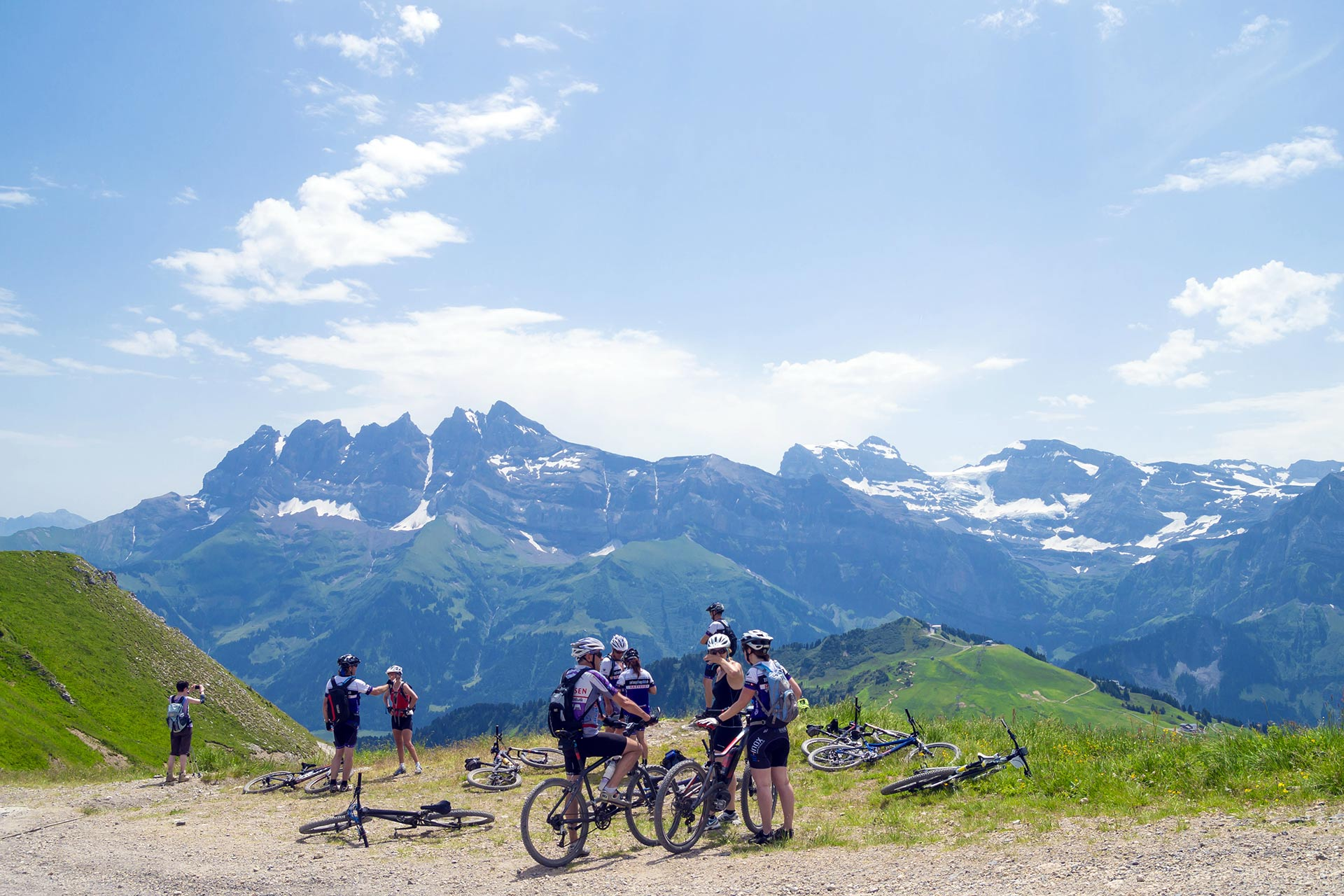 Bikers on the trail in Swiss Alps, Portes du Soleil region touristic