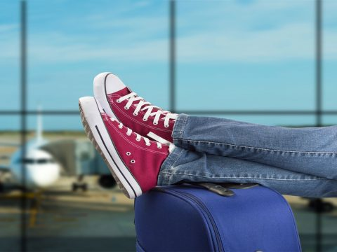 TravelSneakers; Courtesy of cunaplus/Shutterstock.com