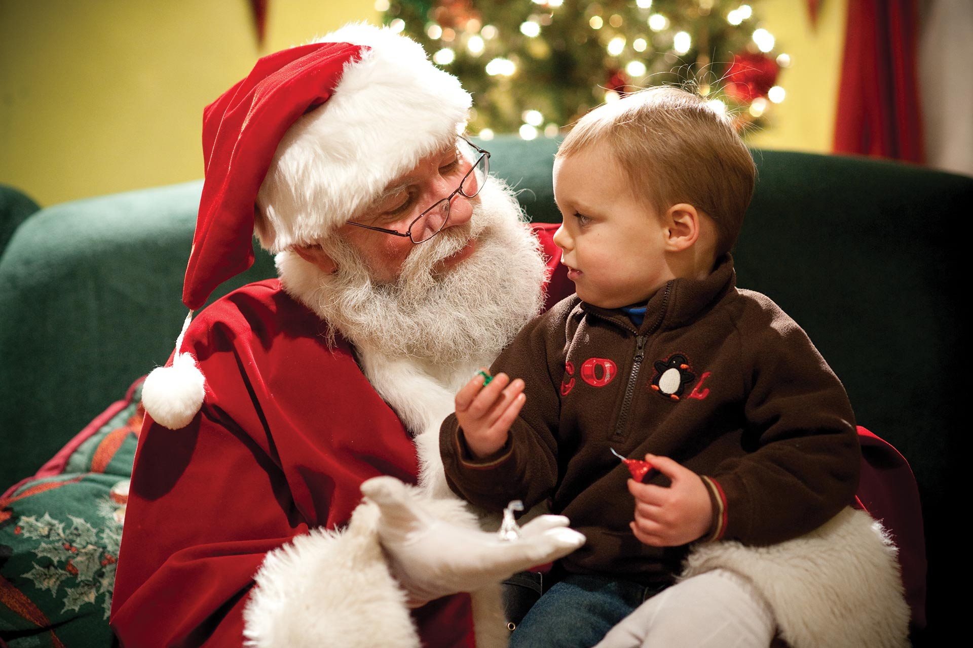 Santa talking to a little boy during Christmas Candylane at Hersheypark in Pennsylvania