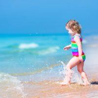 Toddler on the Beach; Courtesy of FamVeld/Shutterstock.com