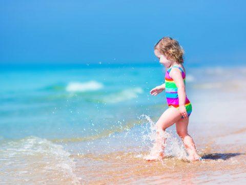 Toddler on the Beach; Courtesy of FamVeld/Shutterstock.com