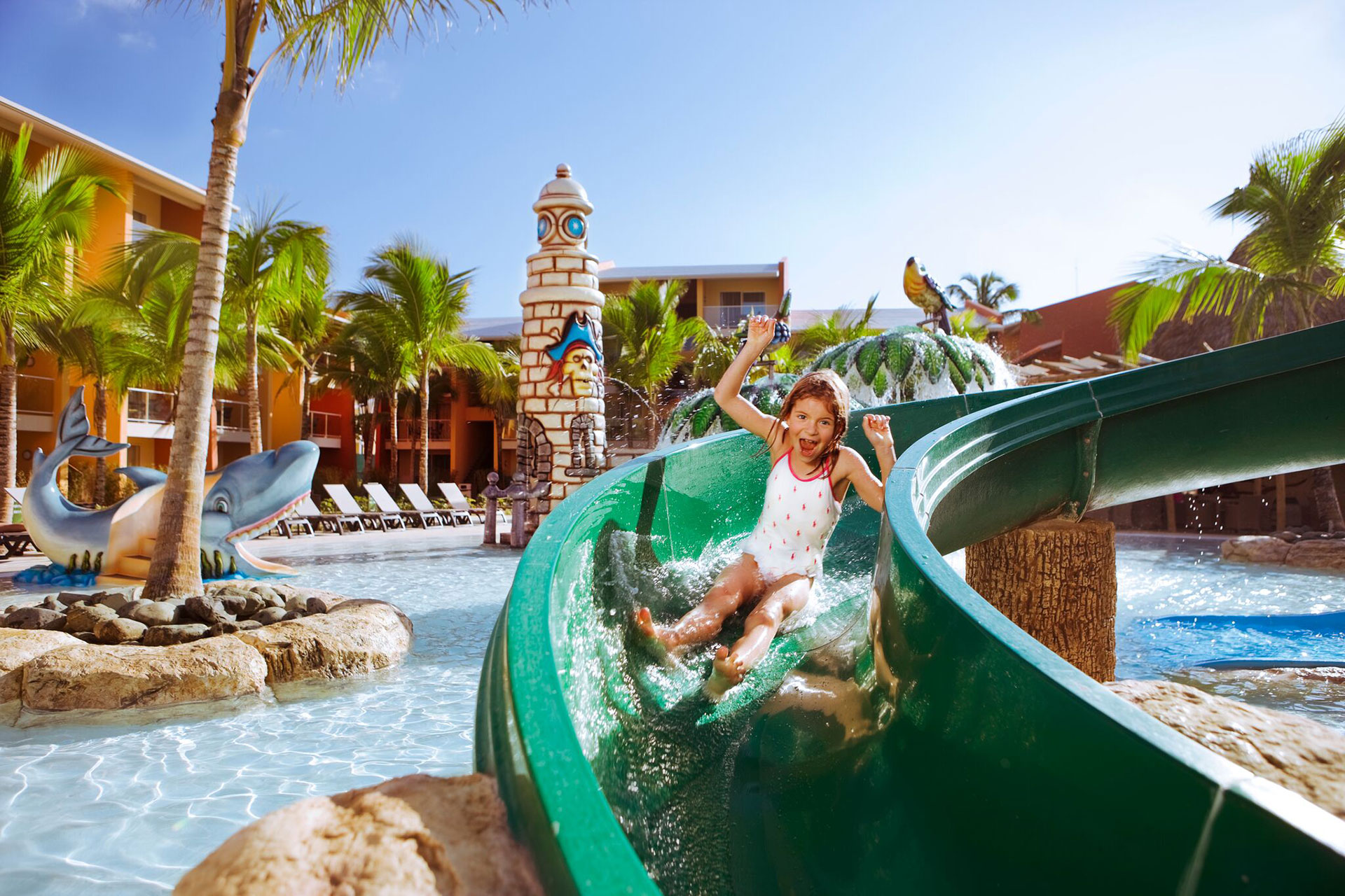 Young girl sliding down water slide at Barcelo Bavaro Palace