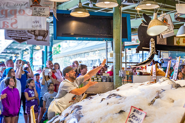 Customers at Pike Place Market; Courtesy of f11photo/Shutterstock.com