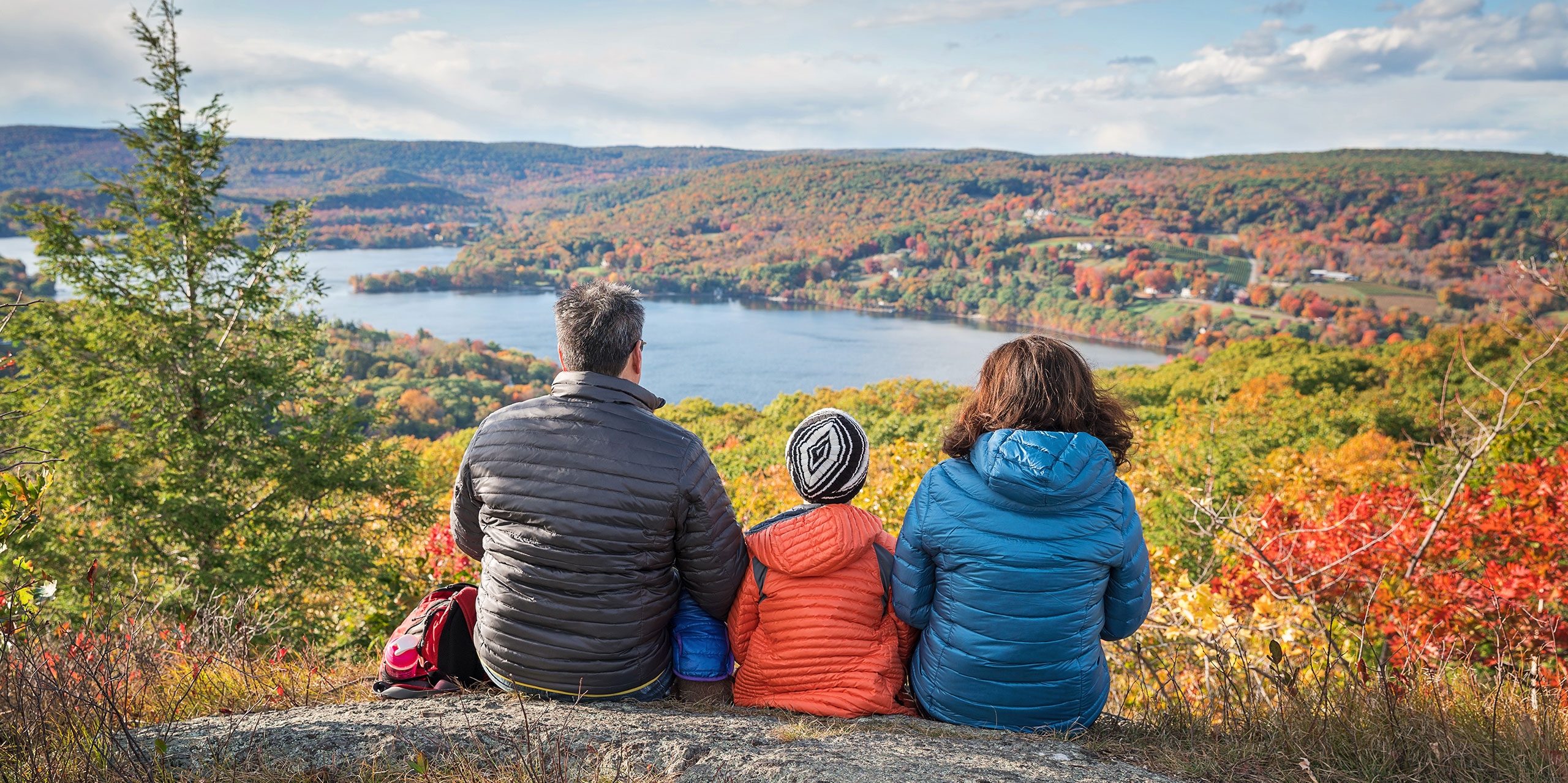 Family Overlooking a Lake in the Fall; Courtesy of Romiana Lee/Shutterstock.com