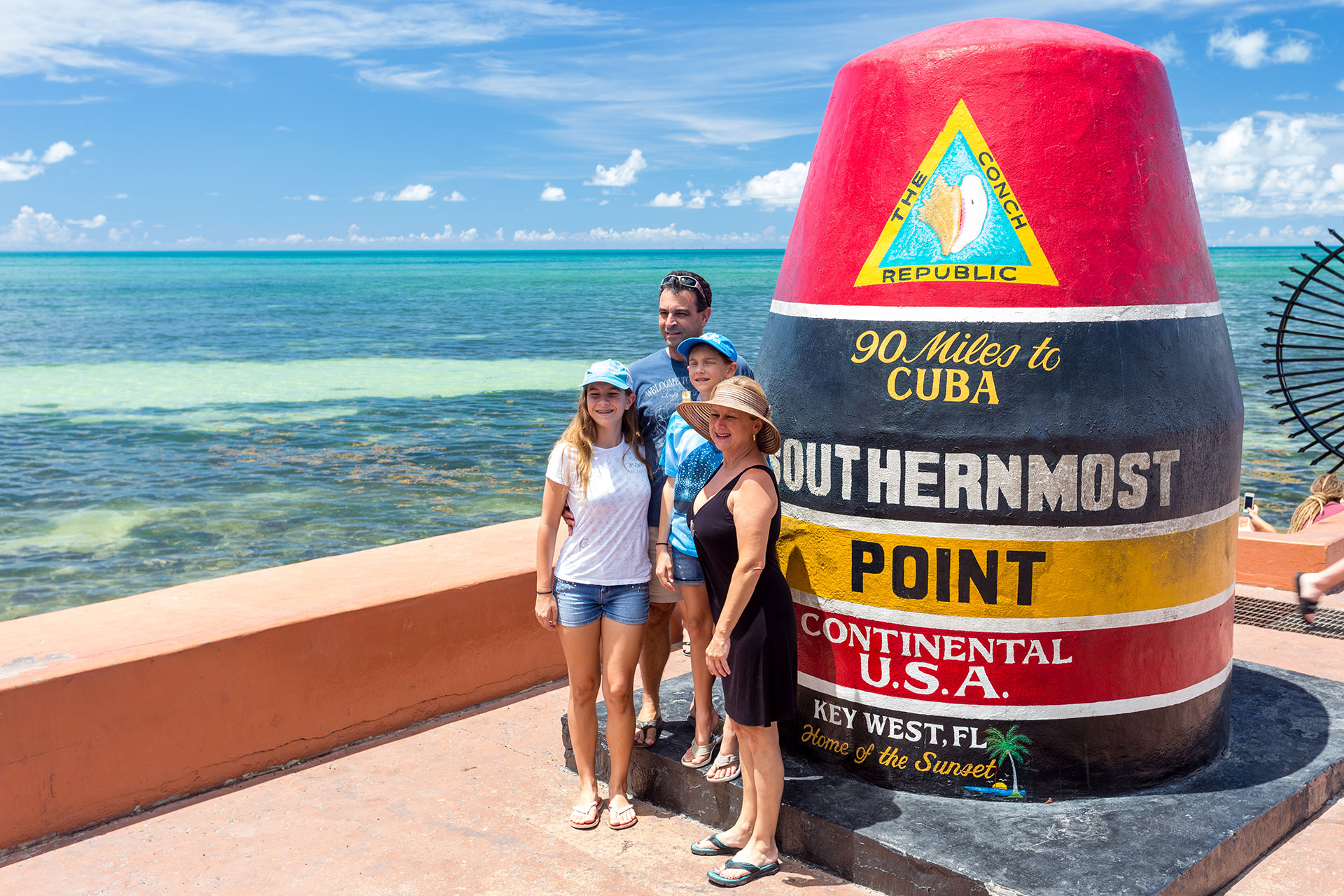 Family at Southernmost Point in Key West, Florida