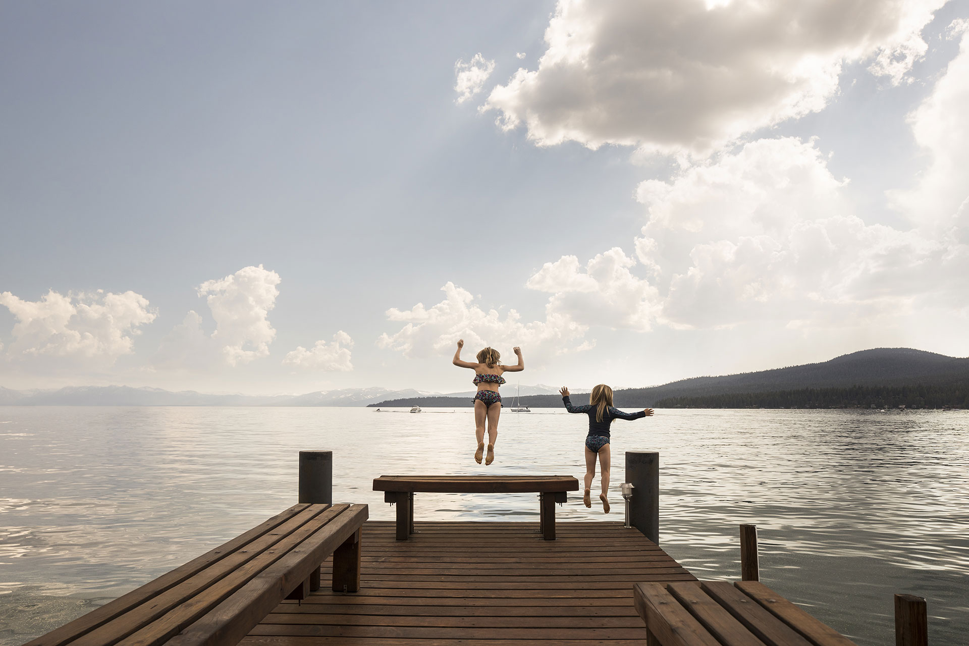 Kids Jumping Off Dock into Water in North Lake Tahoe