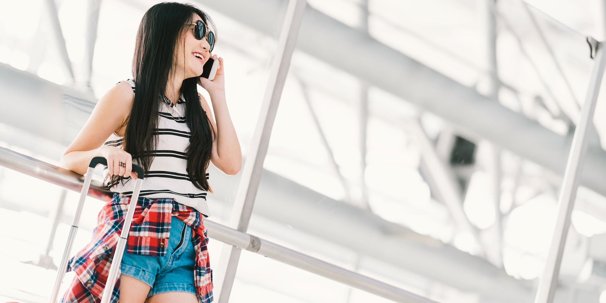 Young Girl at Airport on Phone; Courtesy of Beer5020/Shutterstock.com