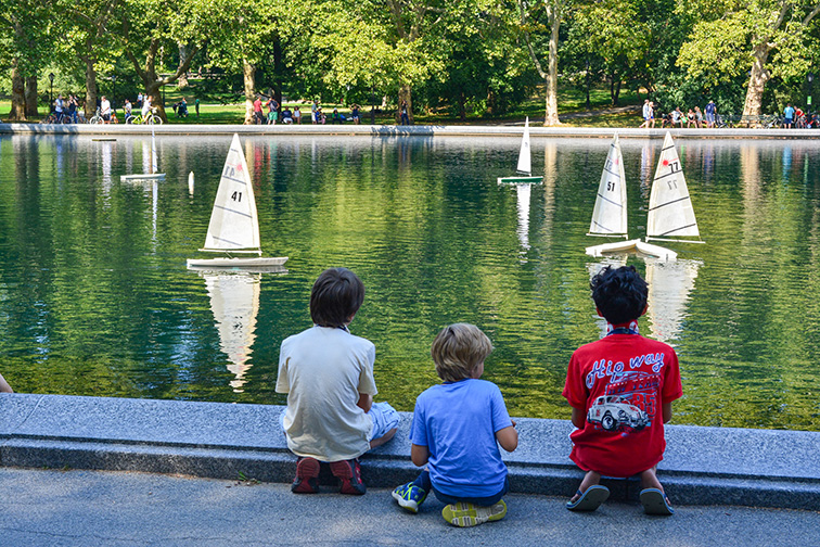 Kids Sailing Miniature Boats on the Water Conservatory in Central Park in New York City; Courtesy of Christopher Penler/Shutterstock.com
