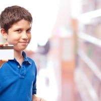Boy With Library Card; Courtesy of Celig/Shutterstock.com