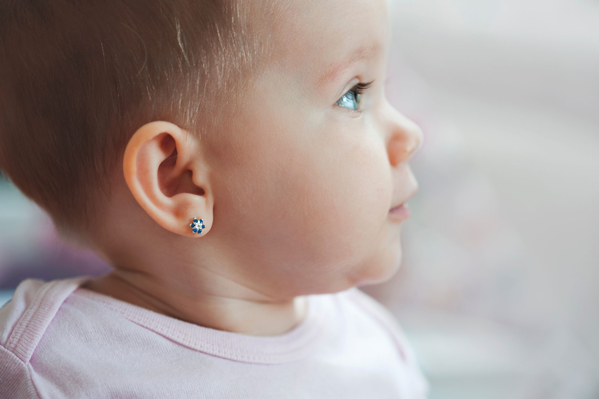 Baby Wearing Earrings; Courtesy of ditifoto/Shutterstock.com