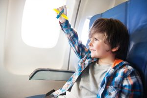 Boy On Airplane; Courtesy of Sergey Novikov/Shutterstock.com