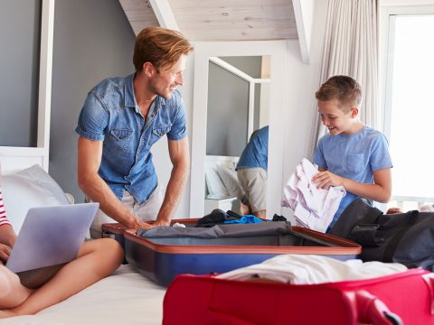 Family Packing for Vacation; Courtesy of Monkey Business Images/Shutterstock.com