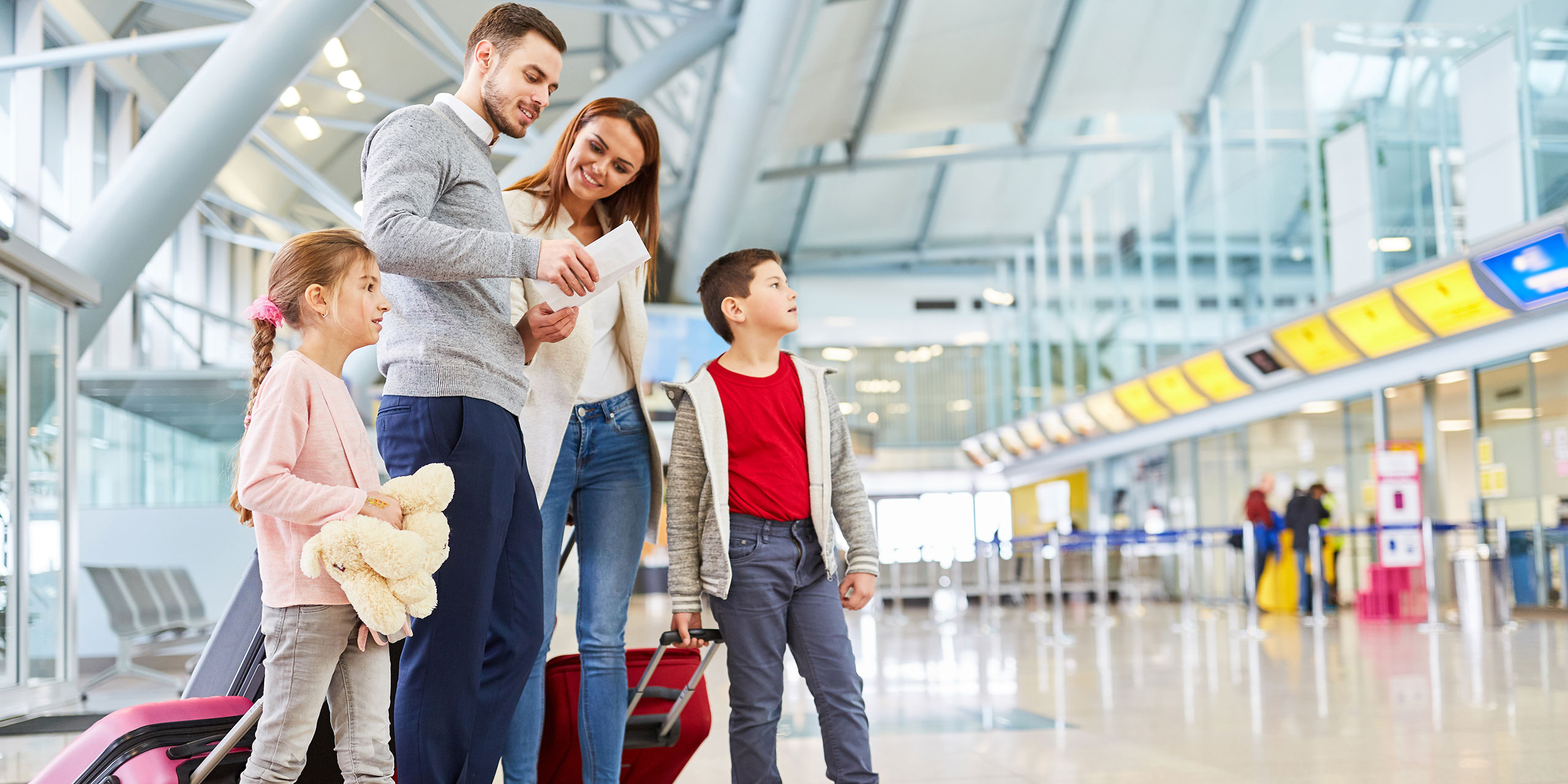 Family Standing in Airport; Courtesy of Robert Kneschke/Shutterstock.com
