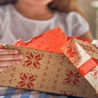 Kid with Holiday Gifts; Courtesy of Yuganov Konstantin/Shutterstock.com