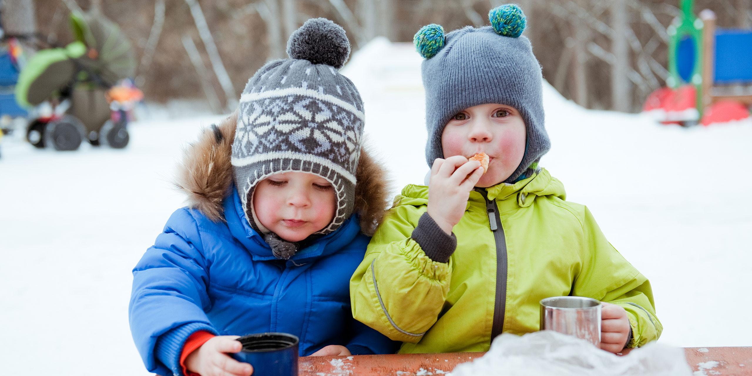 Little Boys Sipping Hot Cocoa; Courtesy of mamaza/Shutterstock.com