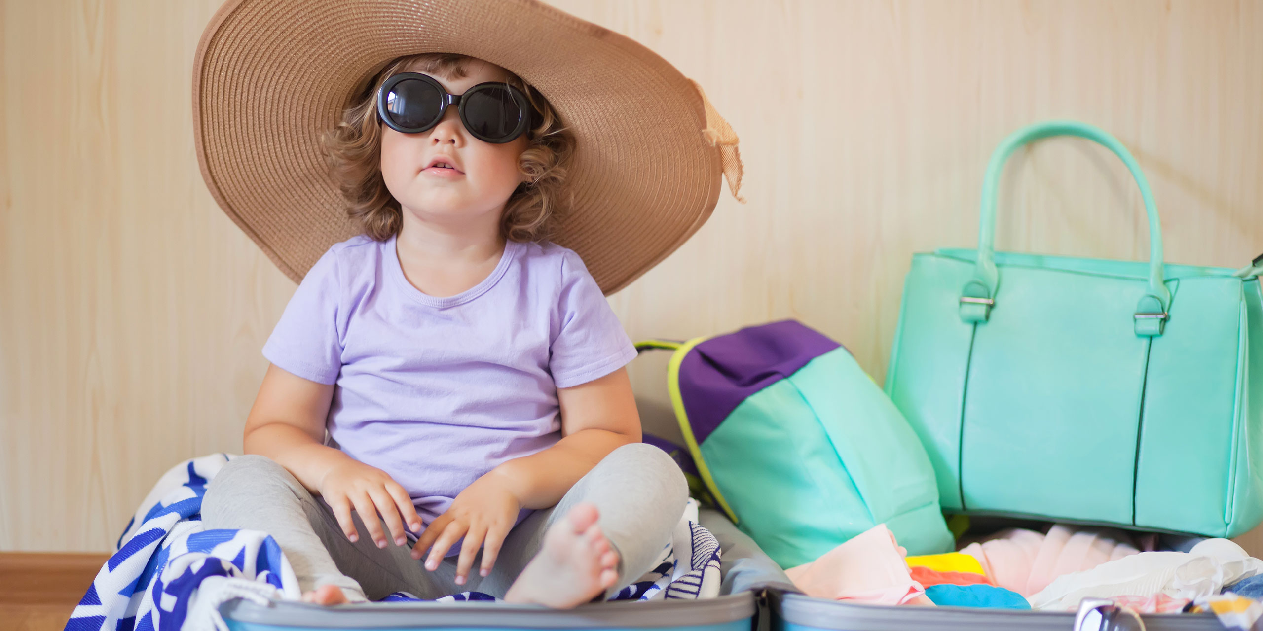 Toddler Girl in Suitcase; Courtesy of Alina Demidenko/Shutterstock.com