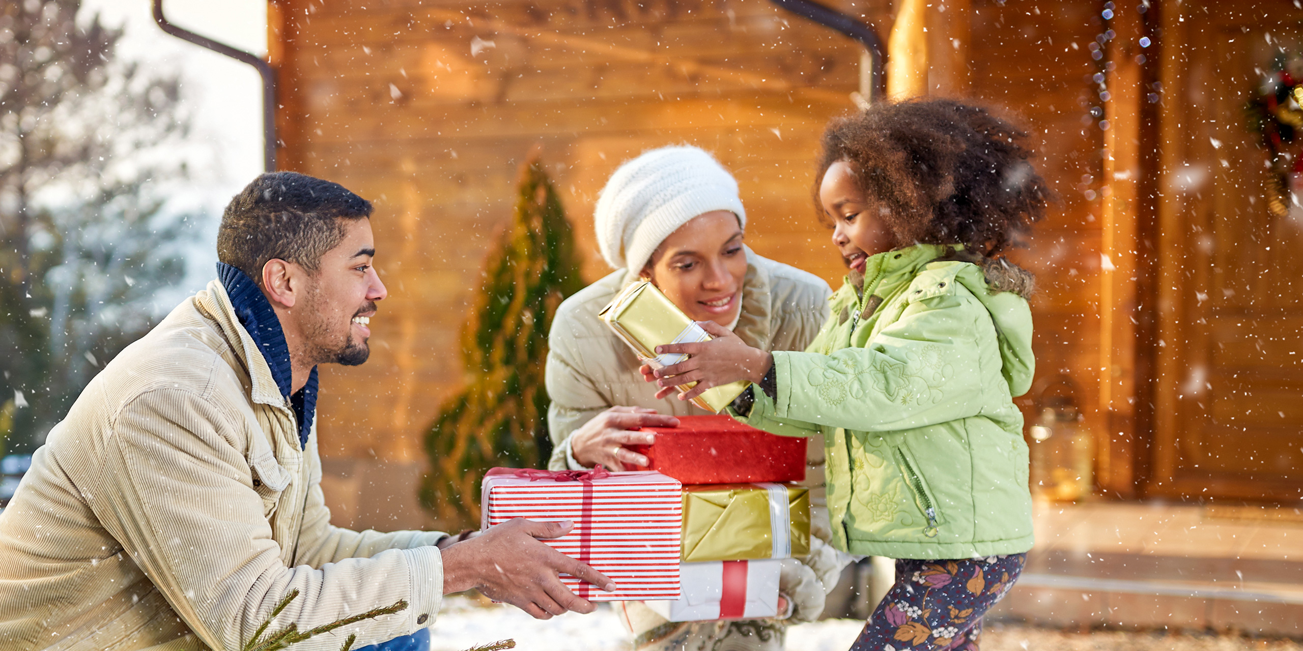 family gift giving holidays snowing; Courtesy of Lucky Business /Shutterstock
