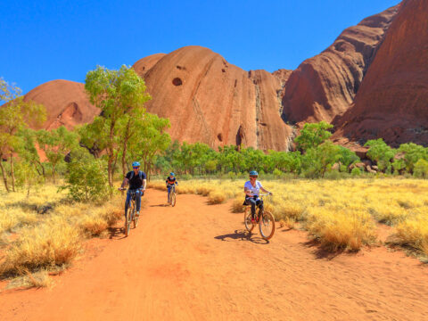 family discovery Ayers Rock with Outback Cycling Ride along Uluru Base Walk in Uluru-Kata Tjuta National Park; Courtesy of Benny Marty/Shutterstock