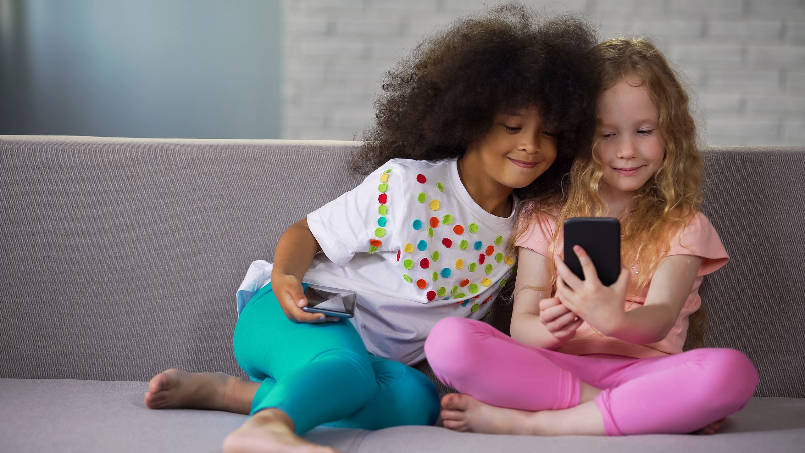 Kids with Gadgets; Courtesy of Motortion Films/Shutterstock.com