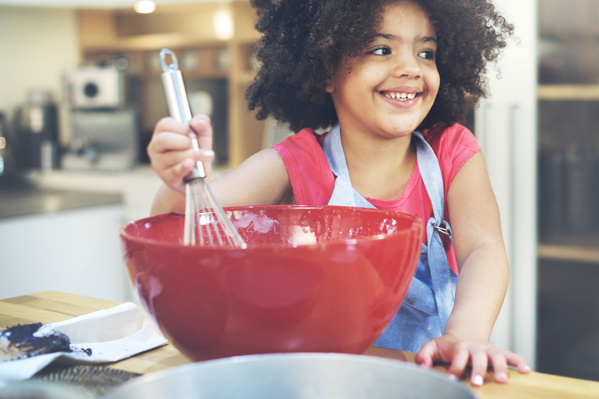Little Girl Mixing Food; Courtesy of Rawpixel.com/Shutterstock.com