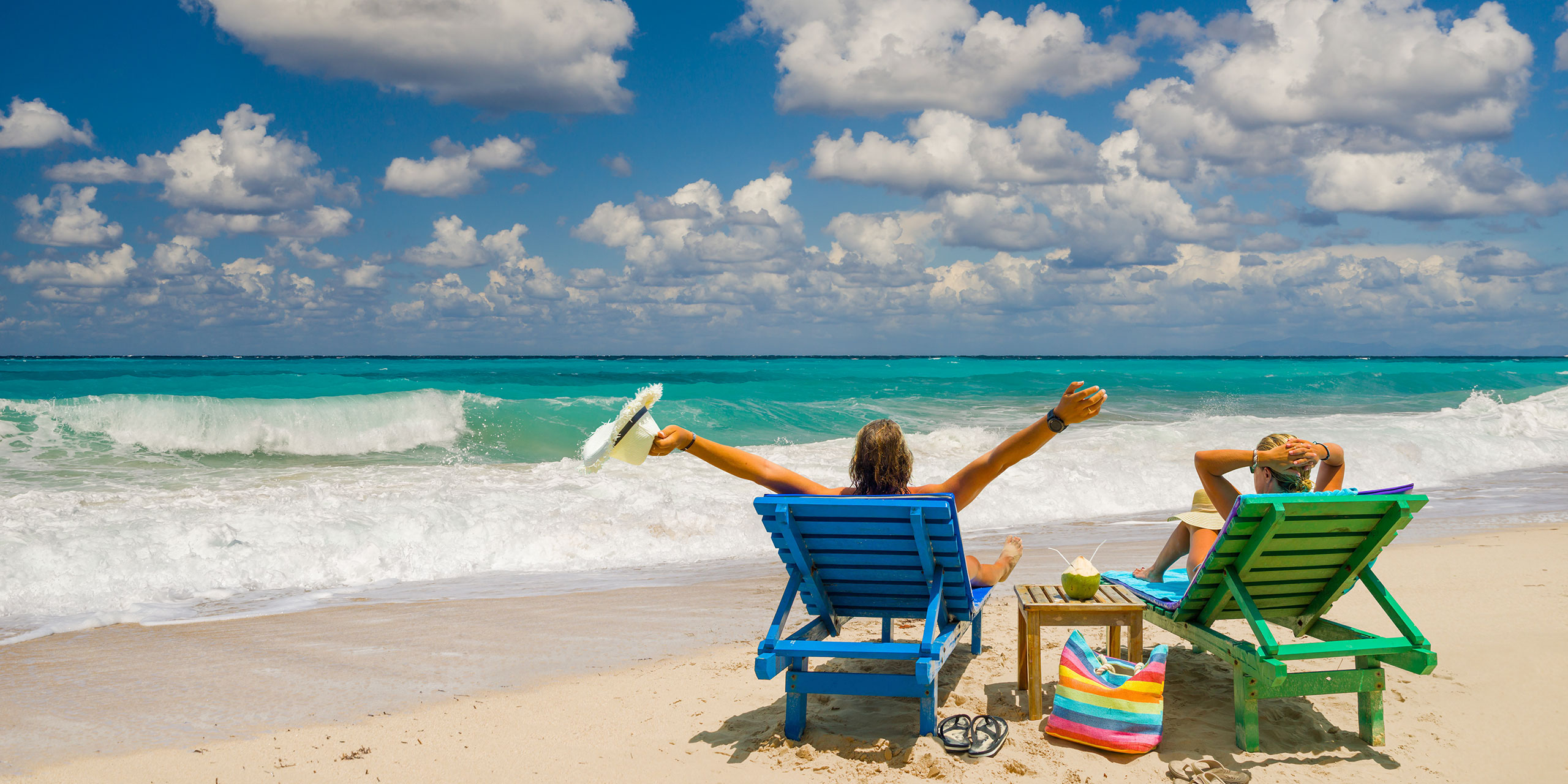 Couple on Beach; Courtesy of Netfalls Remy Musser/ Shutterstock.com
