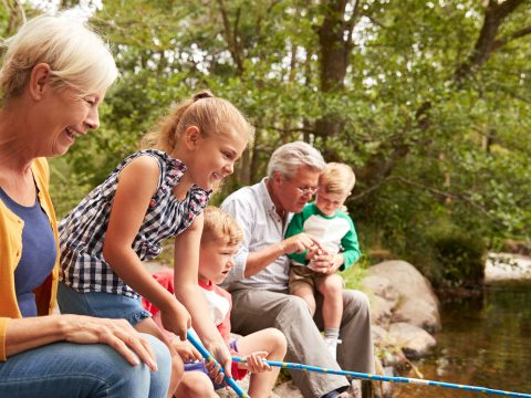 Grandparents and Grandchildren FIshing; Courtesy of Monkey Business Images/Shutterstock.com