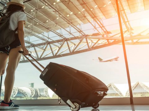 Teen Traveling in Airport; Courtesy of BR Photo Addicted/Shutterstock.com